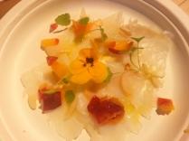carpaccio di baccalà, insalata di pesche, crescioni di anice e mandorle